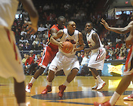 """Ole Miss guard Dundrecous Nelson (5)  is defnded by Georgia's Sherrard Brantley (23) at the C.M. """"Tad"""" Smith Coliseum in Oxford, Miss. on Saturday, January 15, 2011. Georgia won 98-76.  (AP Photo/Oxford Eagle, Bruce Newman)"""