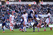 Milton Keynes Dons striker Robbie Muirhead (16) rises highest in the box to head the ball during the EFL Sky Bet League 1 match between Milton Keynes Dons and Charlton Athletic at stadium:mk, Milton Keynes, England on 17 February 2018. Picture by Dennis Goodwin.