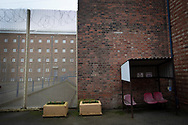 An exterior view of buildings within the precincts of HMP Liverpool, also known as Walton Prison. The prison was given a scathing report in 2017 which pointed out various failings and problems. Present governor Pia Sinha was appointed in that year and in the next two years she turned the prison around with a programme of improvements and support for inmates and infrastructure. HMP Liverpool houses a maximum of 700 prisoners with an overall staff of around 250.