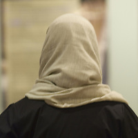 Muslim woman wearing hijab, back view<br />