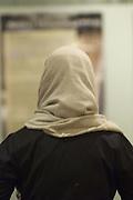Muslim woman wearing hijab, back view<br />