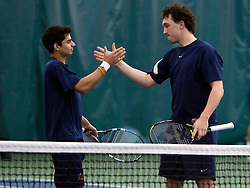 Virginia's #2 ranked doubles team of Sanam Singh (left) and Houston Barrick celebrate after defeating the #44 ranked VT team of Luka Somen and Nicolas Delgado de Robles in #1 doubles.   The #1 ranked Virginia Cavaliers faced the #31 ranked Virginia Tech Hokies in NCAA Men's Tennis at the Boar's Head Sports Club in Charlottesville, VA on February 27, 2009.