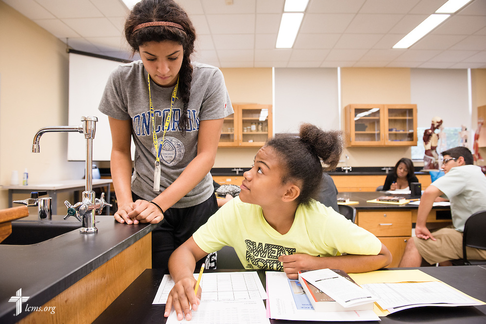 Mariah Berry helps a new student during an orientation session at Concordia College New York on Saturday, July 19, 2014, in Bronxville, NY. LCMS Communications/Erik M. Lunsford