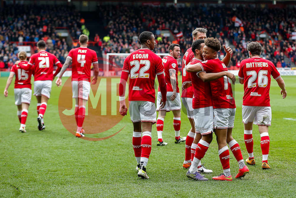 Bobby Reid of Bristol City celebrates with Korey Smith after scoring a goal to make it 2-0 - Mandatory byline: Rogan Thomson/JMP - 09/04/2016 - FOOTBALL - Ashton Gate Stadium - Bristol, England - Bristol City v Sheffield Wednesday - Sky Bet Championship.
