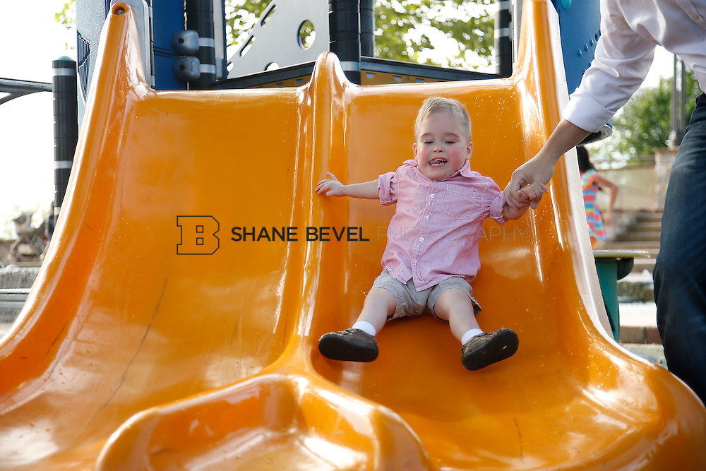 5/28/15 6:04:57 PM -- Miracle Miles and his family pose for portraits and play at the QuikTrip park for the 2015 Saint Francis Health System advertising campaign. <br /> <br /> Photo by Shane Bevel