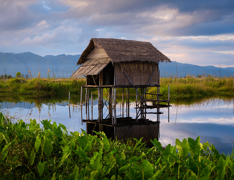 INLE LAKE, MYANMAR - CIRCA DECEMBER 2017: Typical hut built on stilts in Inle Lake, Myanmar
