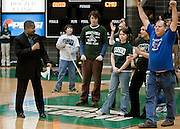 Ed Newman, creator of Recyclemania, right, raises his arms in recognition after being introduced byOU President McDavis during half-time of the Ohoi University and Central Michagan basketball game in Athens, Ohio. photo by Kevin Riddell