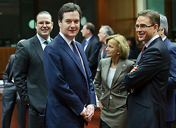 George Osborne, the UK's chancellor of the exchequer,  center, speaks with Anders Borg, Sweden's finance minister, left, Elena Salgado, Spain's finance minister, center right, and Jyrki Katainen, Finland's finance minister, far right, during a meeting of EU finance ministers, at the European Council headquarters, in Brussels, Tuesday, Dec. 7, 2010. (Photo © Jock Fistick).