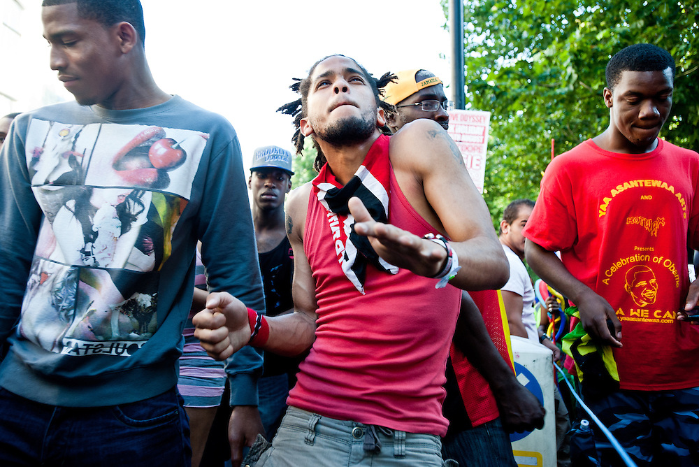 London, UK - 26 August 2013:  a young man dances for the camera during the annual parade at the Notting Hill Carnival.