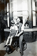 adult person with child casual posing in front of house England 1940s
