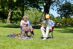 © Licensed to London News Pictures. 19/05/2020. London, UK. Members of the public relax in Finsbury Park, north London on a warm and sunny day in the capital. The government has relaxed the rules on the COVID-19 lockdown, allowing people to spend more time outdoors whilst following social distancing guidelines. According to the Met Office, 27 degrees celsius is forecast for tomorrow. <br /> <br /> ***Permission Granted***<br /> <br /> Photo credit: Dinendra Haria/LNP