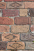 Old engraved brick in the historic district in St. Augustine, Florida. St Augustine is the oldest city in America.