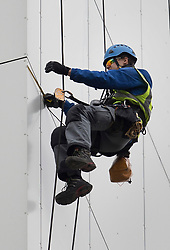 © Licensed to London News Pictures. 27/06/2017. London, UK. A specialist abseils down the face of Bray tower block to inspect cladding on the Chalcots Estate in Camden after it failed a fire inspection because of combustable cladding. More than 700 flats in tower blocks on an estate in the Swiss Cottage area of north-west London are being evacuated because of fire safety concerns after the Grenfell Tower fire of on June 14. Photo credit: Peter Macdiarmid/LNP