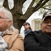 Karenne Wood, Monacan, listens as Alan Michelson, a Mohawk member of Six Nations of the Grand River, speaks during the dedication ceremony for Mantle: Virginia Indian Tribute, a monument designed on Virginia State Capitol Square, in Richmond, Virginia, on Tuesday, April 17, 2018. Michelson, a New York based artist, designed the monument in Capitol Square next to the Bell Tower along North Ninth Street. John Boal Photography