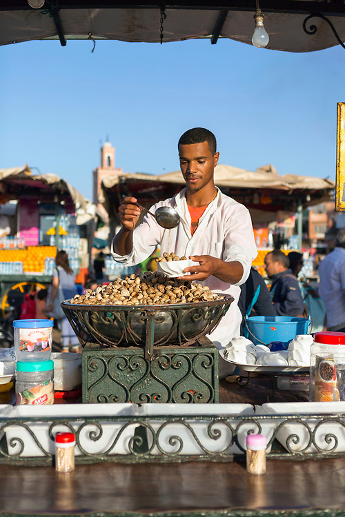 Traditional 'escargot,' local Marrakeshi / Moroccan cuisine dish, Marrakech, Morocco, 2015–05-06.<br /><br />The smell of the mixture of spices coming from 'escargot' stands up and down the streets of Morocco is alluring for some, but equally off-putting for others. <br /><br />Involving a very unique blend of spices consisting of; thyme, mint, bitter orange peel, pepper, liquorice root and crushed arabic gum (made from acacia trees), the dish creates a fragrant aroma to the street surrounding each stall.<br /><br />The delicacy is eaten all over Morocco but is especially easy to find in Jemaa el-Fna, the main square of Marrakesh, where street food is abundant.