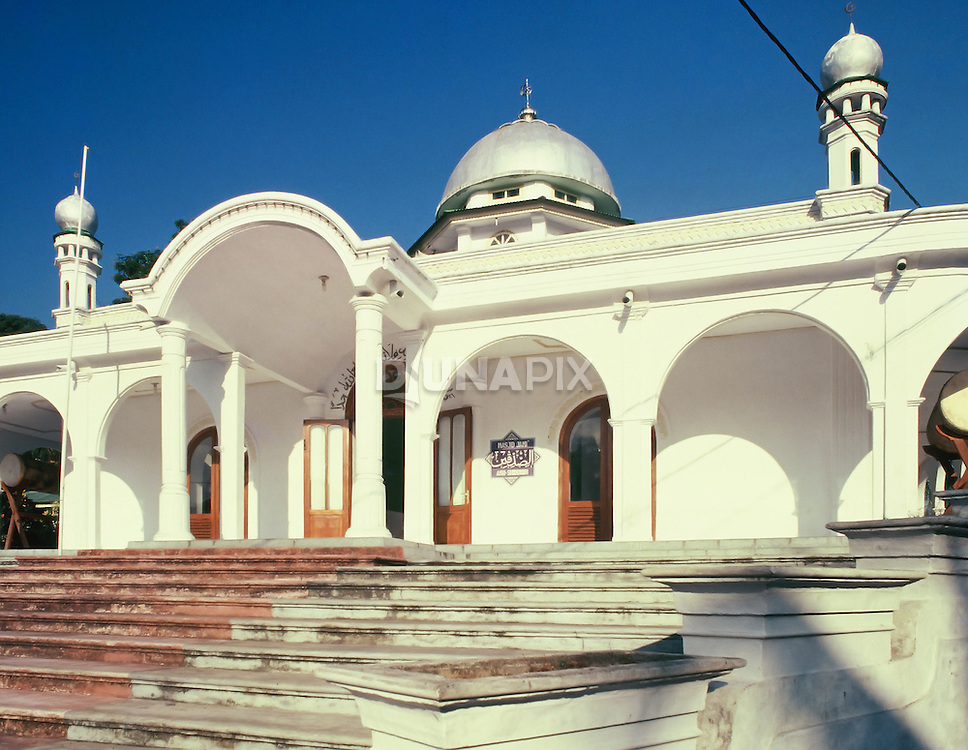 Gleaming white mosque, Banda Neira, Maluku, Indonesia. During the Ambon conflict of the early 2000's, many Muslims fled to Banda.