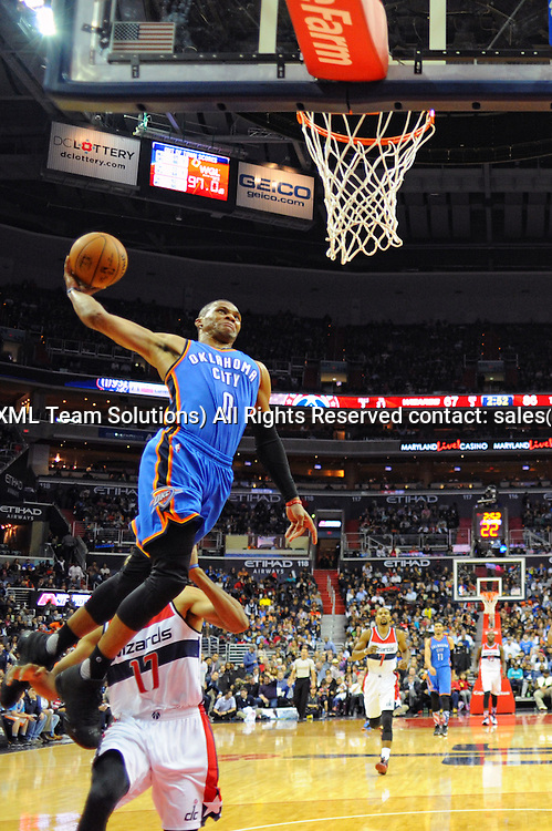 10 November 2015:  Oklahoma City Thunder guard Russell Westbrook (0) dunks the ball at the Verizon Center in Washington, D.C. where the Oklahoma City Thunder defeated the Washington Wizards, 125-101. (Photograph by Icon Sportswire)