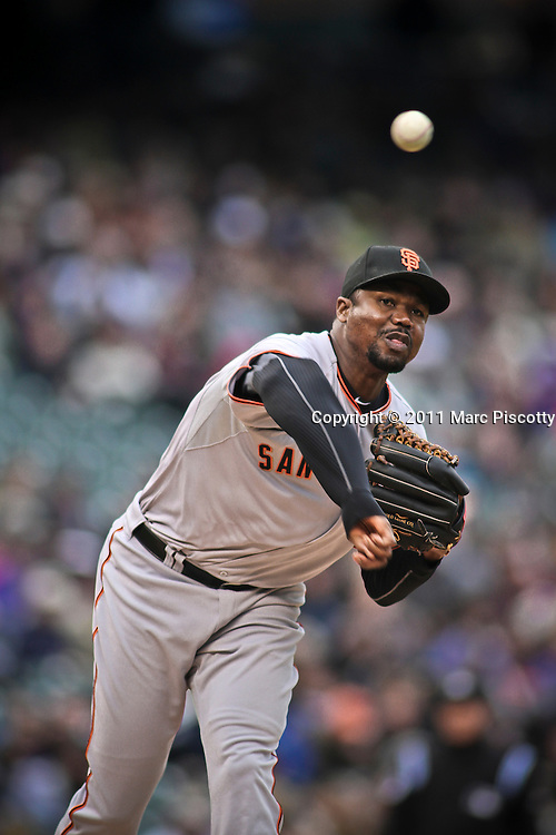 SHOT 4/20/11 3:39:38 PM - San Francisco Giants relief pitcher Guillermo Mota throws to first base during their game at Coors Field against the Colorado Rockies in Denver, Co. The Rockies won the game 10-2 and avoided a sweep in the series after the Giants had taken the first two games. (Photo by Marc Piscotty / © 2011)