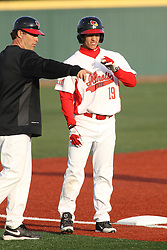 21 April 2015:  Bo Durkac chats with base runner Jared Hendren at third base during an NCAA Inter-Division Baseball game between the Illinois Wesleyan Titans and the Illinois State Redbirds in Duffy Bass Field, Normal IL