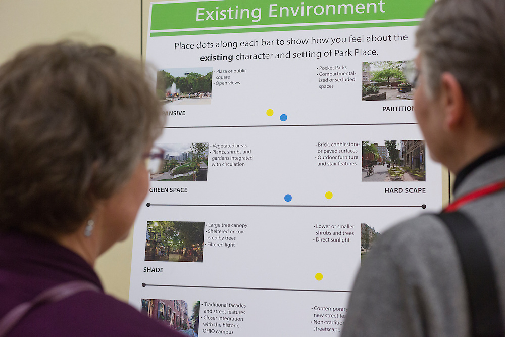 Dianne Bouvier, left, and Betty Hollow, right, look at one of the boards at the Park Place public planning workshop at the Athens Community Center on Feb. 22, 2017.
