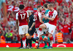 (left to right) Arsenal's Alex Iwobi, Arsenal's Calum Chambers and Arsenal's Per Mertesacker celebrate after the final whistle