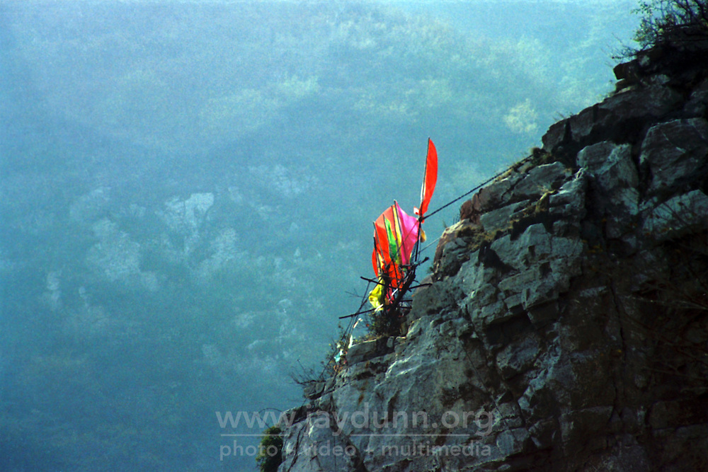 China, Taiyuan, 2008. Perched on an inaccessible cliff face, a colorful Buddhist shrine beckons travelers on foot up the steep paths of Juewei Mountain.