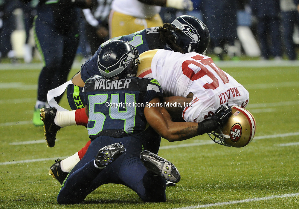 December 23, 2012: CenturyLink Field, Seattle, Washington: Seattle Seahawks middle linebacker Bobby Wagner (54) brings down San Francisco 49ers tight end Delanie Walker (46) as the Seattle Seahawks lead the 49ers 28-6 at the half.