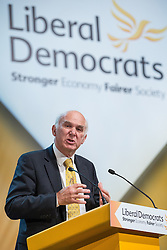 © Licensed to London News Pictures . 06/10/2014 . Glasgow , UK . VINCE CABLE , Secretary of State for Business, Innovation and Skills addresses the conference during a debate on housing . The Liberal Democrat Party Conference 2014 at the Scottish Exhibition and Conference Centre in Glasgow . Photo credit : Joel Goodman/LNP