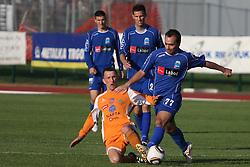 Gregor Bunc of Nafta vs Sead Zilic of Drava at football match of 31st Round of 1st Slovenian League  between NK Drava and NK Nafta, on April 17, 2010, in Ptuj, Slovenia. (Photo by Marjan Kelner / Sportida)