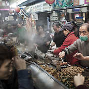 A food stall dish up a variaty of deep fry crab stick, meat dublings, fish balls etc to a hungry crowd in Times Square. <br />