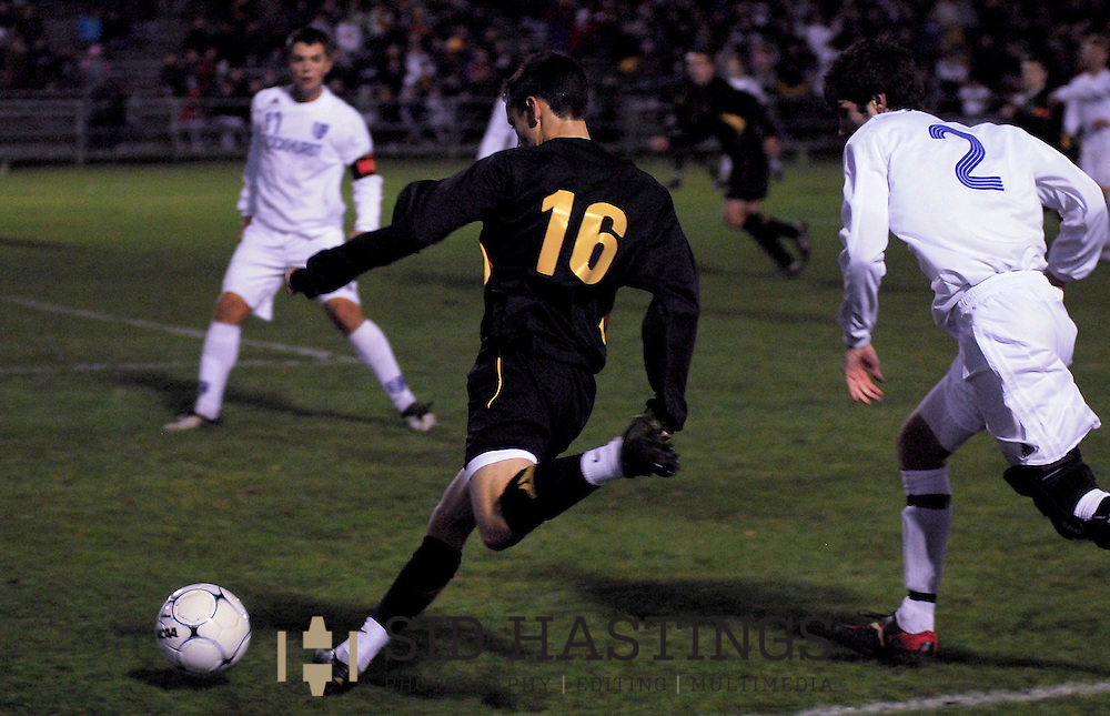 20 NOV. 2010 -- FENTON, Mo. -- St. John Vianney High School soccer player Jason Hackett (16) launches a shot on goal during the game between the Golden Griffins and Rockhurst High School in the MSHSAA Class 3 soccer championship game at the Anheuser-Busch Center in Fenton, Mo. Saturday, Nov. 20, 2010. Rockhurst won the title, beating Vianney 3-1. Image © copyright 2010 Sid Hastings.
