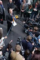 27 FEB 2002, BERLIN/GERMANY:<br /> Rudolf Scharping, SPD, Bundesverteidigungsminister, gibt ein Pressestatement nach einer Sitzung des Verteidigungsausschusses, Deutscher Bundestag<br /> IMAGE: 20020227-02-011<br /> KEYWRDS: Journalist, Journalisten, Mikrofon, Microphone, kamera, Camera