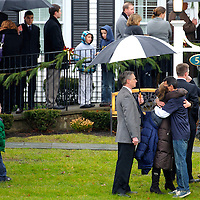 Attendees embrace while gathering for the funeral of Jack Pinto, 6, at Honan Funeral Home in Newtown, CT, on December 17, 2012, 3 days after a mass shooting of 20 children and 7 adults at Sandy Hook Elementary School.