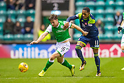 Joe Newell (#11) of Hibernian FC pulls back Lewis Stevenson (#16) of Hibernian FC during the Ladbrokes Scottish Premiership match between Hibernian FC and Hamilton Academical FC at Easter Road Stadium, Edinburgh, Scotland on 22 January 2020.