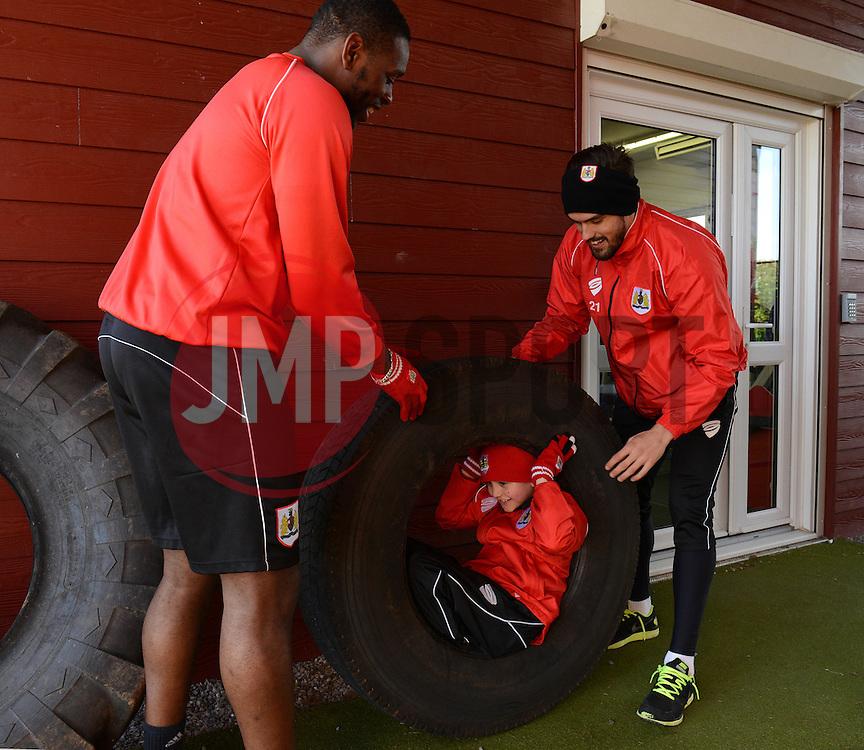 Bristol City's Marlon Pack and Bristol City's Jay Emmanuel-Thomas joke around with Connor - Photo mandatory by-line: Dougie Allward/JMP - Mobile: 07966 386802 - 01/04/2015 - SPORT - Football - Bristol - Bristol City Training Ground - HR Owen and SAM FM
