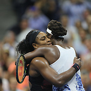 Serena Williams, USA and sister Venus Williams, USA, embrace after in their Women's Singles Quarterfinals match won by Serena during the US Open Tennis Tournament, Flushing, New York, USA. 8th September 2015. Photo Tim Clayton