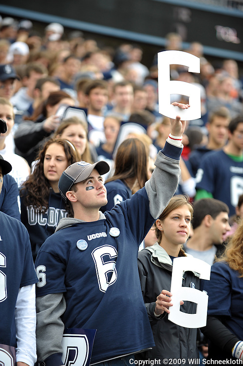 Oct 31, 2009; East Hartford, CT, USA; A Connecticut student holds a #6 cutout in memory of slain Connecticut player Jasper Howard during pre game ceremonies for Big East NCAA football action between Rutgers and Connecticut at Rentschler Field.