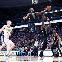 01 April 2018: Milwaukee Bucks forward Khris Middleton (22) reaches for the rebound during the Denver Nuggets 128-125 victory over the Milwaukee Bucks, at the Pepsi Center, Denver, Colorado, USA.