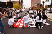 04/25/12-  Andy DeLisle.Protestors in the March for Justice against SB 1070 block the street outside the Phoenix I.C.E office on Wednesday April, 25 2012 in Phoenix, AZ.
