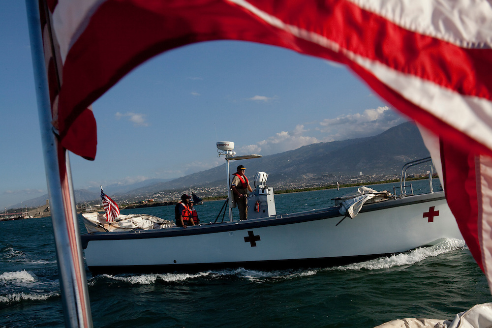 A utility boat scouts locations to retrieve patients from the shore by boat and bring them to the USNS Comfort, a naval hospital ship, for treatment on Wednesday, January 20, 2010 in Port-Au-Prince, Haiti. The Comfort deployed from Baltimore, bringing nearly a thousand medical personnel to care for victims of Haiti's recent earthquake.
