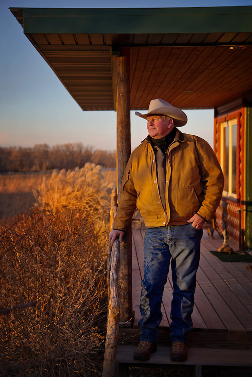 """Rancher Randy Thompson owns land in Nebraska where TransCanada's Keystone Pipeline is proposed to cross. Thompson, who is a symbol of the opposition and one of the three landowner plaintiffs in Thompson v. Heineman, has had his likeness used on bumperstickers and t-shirt in the anti-pipeline slogan """"I Stand with Randy"""" after he was arrested in Washington, D.C. for protesting the Keystone in 2013. 