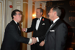 Left to right, LORD GRIMTHORPE, the HON.HARRY HERBERT and LAURENT FENIOU at the 26th Cartier Racing Awards held at The Dorchester, Park Lane, London on 8th November 2016.