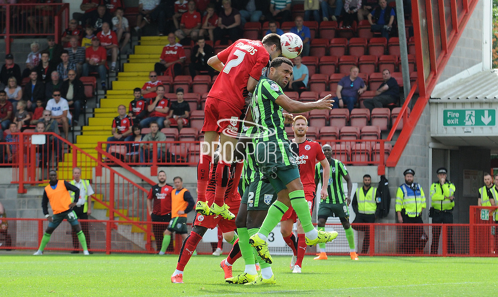 Gwion Edwards heads Crawley into the lead during the Sky Bet League 2 match between Crawley Town and AFC Wimbledon at the Checkatrade.com Stadium, Crawley, England on 15 August 2015. Photo by Michael Hulf.