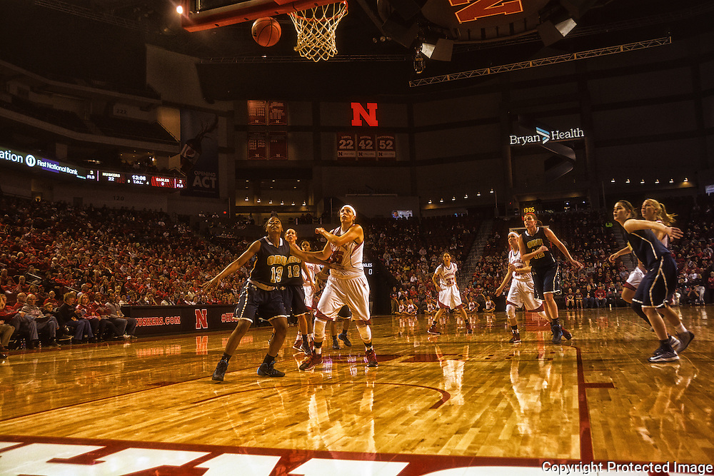 Nebraska Huskers - Oral Roberts women basketball players eye for rebound. - Photo by Mosley Images, Lincoln, Nebraska.