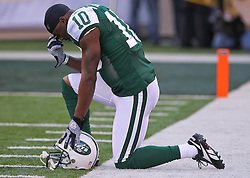 Dec 24, 2011; East Rutherford, NJ, USA; New York Jets wide receiver Santonio Holmes (10) prays before the first half of their game against the New York Giants at MetLife Stadium.
