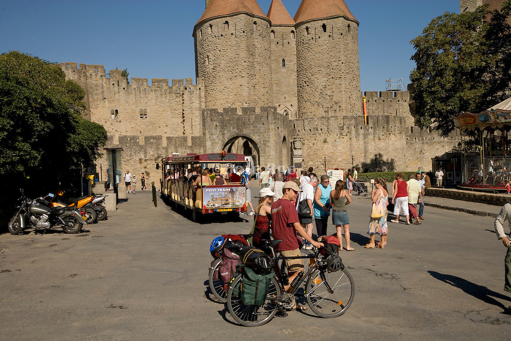 tourists walking in front of La Cite Carcasonne France
