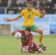 Bristol - Saturday November 7th, 2009: Darel Russel of Norwich City and Phil Waters of Paulton Rovers during the FA Cup 1st round match at Paulton. (Pic by Alex Broadway/Focus Images)..
