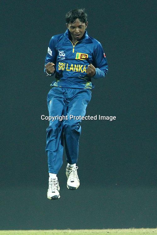 Akila Dhanajaya celebrates the wicket of Stuart Broad (Captain) of England  during the ICC World Twenty20 Super Eights match between England and Sri Lanka held at the  Pallekele Stadium in Kandy, Sri Lanka on the 1st October 2012<br /> <br /> Photo by Ron Gaunt/SPORTZPICS