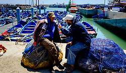 Two fishermen chatting beside the harbour, Essaouira, Morocco<br /> <br /> (c) Andrew Wilson | Edinburgh Elite media