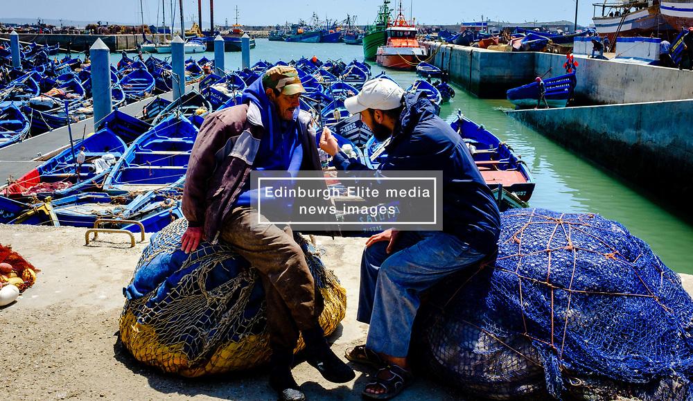 Two fishermen chatting beside the harbour, Essaouira, Morocco<br /> <br /> (c) Andrew Wilson   Edinburgh Elite media